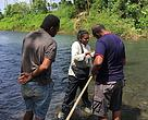 Community representatives work with Fresh water invertebrate scientist Bindiya Rashni in assessing the health of streams that feed into the Dreketi river.