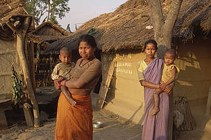 Women with their children in local village, on the outskirts of Royal Chitwan National Park, Nepal.